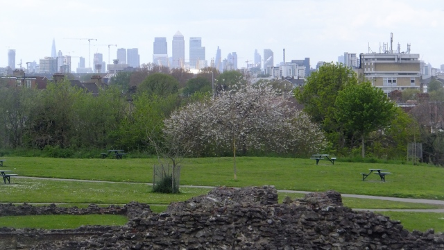 Abbey ruins with London skyline beyond