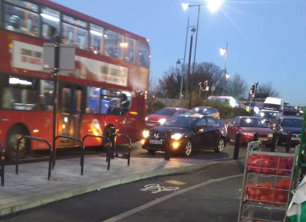 Buses at major stop navigating poor parking